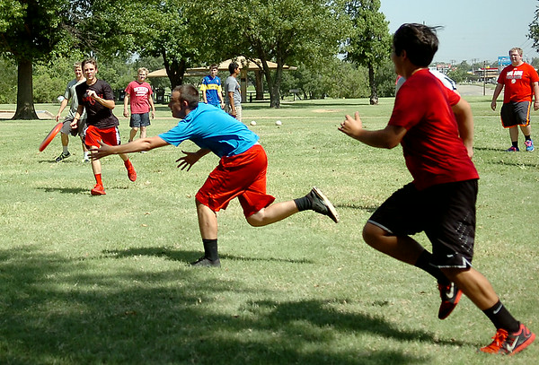 OBA High School students play frisbee football during fun day activities at Meadowlake Park Wednesday, August 20, 2014. (Staff Photo by BONNIE VCULEK)