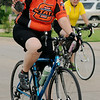 A lady rider sports her favorite team colors as she joins other riders during the 9th annual AMBUCS Tour de Trykes at David Allen Memorial Ballpark Saturday, August 16, 2014. The courses ranged from 2, 14, 26, and 42 miles or a 100k race. More than 400 bicyclists registered for the ride that raises money for local AMBUCS projects. (Staff Photo by BONNIE VCULEK)