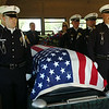 """The Enid Police Department Honor Guard honor Retired Capt. Glenn """"Red"""" Willard Harmon during Harmon's Celebration of Life and Interment at Memorial Park Cemetery Tuesday, August 26, 2014. (Staff Photo by BONNIE VCULEK)"""