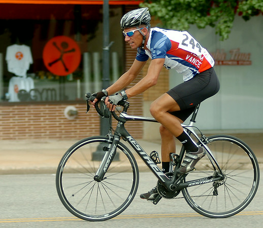 Matt Bell, with Team Vance at Vance Air Force Base, leads the Tour de Trykes Twilight Criterium Men's Open in downtown Enid Saturday, August 16, 2014. (Staff Photo by BONNIE VCULEK)