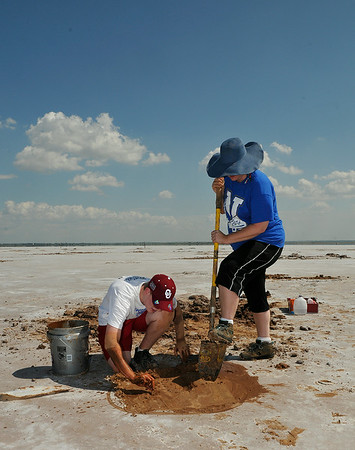 Thomas White and Tara Cain, from Newkirk, made a stop to dig for selenite crystals Saturday at the Salt Plains National Wildlife Refuge near Jet while driving to Black Mesa to go hiking. Crystal digging is allowed until October 15. (Staff Photo by BILLY HEFTON)