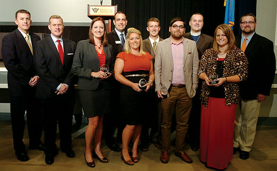 The 2014 Enid Young Professionals' 10-Under 40 award recipients (from left) were Kaleb Hennigh, Shaun Cummings, Jessica Caruthers, Keller Taylor, Christy Baker, Jay Bowers, Ben Ezzell, Rev. Andrew Long, Stephanie Randolph and Cody Jolliff. The winners were selected from 27 outstanding nominees. The presentations were announced during a luncheon at the Enid Event Center and Convention Hall Grand Ballroom Thursday, August 28, 2014. (Staff Photo by BONNIE VCULEK)