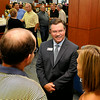 New Enid Public Schools superintendent, Dr. Darrell Floyd, visit with guest during a reception Tuesday at the Enid High Library. (Staff Photo by BILLY HEFTON)