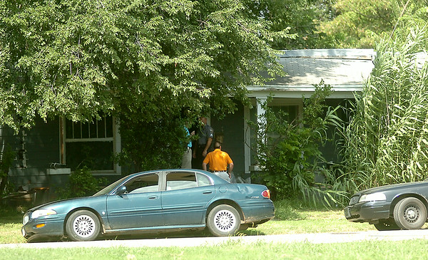 The Enid Police Department issues a narcotics search warrant at 424 S. Monroe Thursday, August 14, 2014. (Staff Photo by BONNIE VCULEK)