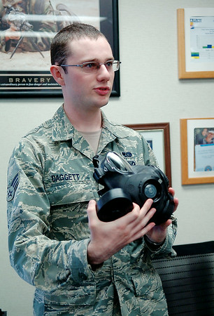 Airman Joshua Daggett explains the features of the new generation gas mask during an interview in the Logistics Readiness Squadron facility at Vance Air Force Base Wednesday, August 20, 2014. Daggett, a member of the Vance Emergency Management Squadron, is following in his father's career footsteps. (Staff Photo by BONNIE VCULEK)