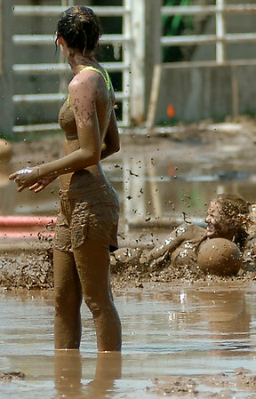 Mud flies into the air as a player dives for the ball during the 3rd annual Enid Miracle League Mud Volleyball Tournament at the Garfield County Fairgrounds Saturday, August 02, 2014. Twenty-two teams from across Oklahoma competed during the fundraiser for Miracle League baseball players with special needs. (Staff Photo by BONNIE VCULEK)