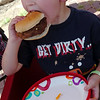 Castiel Gividen devours a grilled burger during Enid Mack Motor Mania at Leonardo's Children's Museum Saturday, August 23, 2014. (Staff Photo by BONNIE VCULEK)