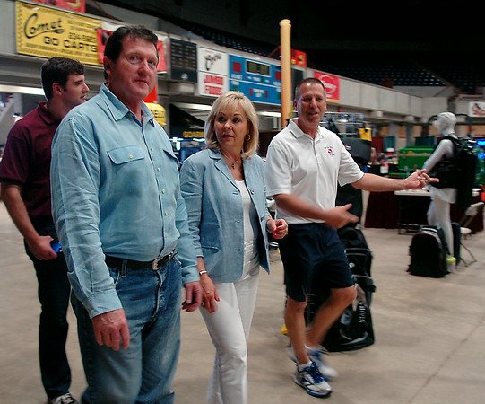 Oklahoma Gov. Mary Fallin (second, from left) and her husband Wade Christensen arrive at the KNID Sportsman's and Outdoor Expo at the Chisholm Trail Coliseum Saturday, August 23, 2014. Gov. Fallin plans several stops during her 2014 re-election campaign bus tour across Oklahoma. (Staff Photo by BONNIE VCULEK)