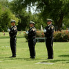 """The Enid Police Department Honor Guard prepares for a 21-gun salute to Retired Capt. Glenn """"Red"""" Willard Harmon during his Celebration of Life and Interment at Memorial Park Cemetery. Harmon served on the department for 38 years. (Staff Photo by BONNIE VCULEK)"""