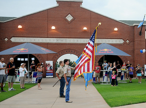 Boy Scouts of America post the colors during the National Anthem at David Allen Memorial Ballpark before the start of the 9th annual AMBUCS Tour de Trykes Saturday, August 16, 2014. (Staff Photo by BONNIE VCULEK)