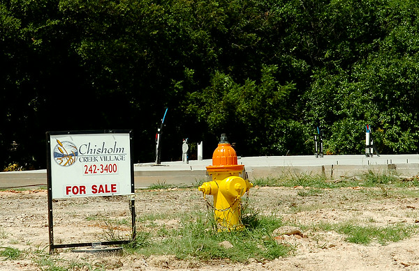 The foundation of a new home appears near a fire hydrant as six new homes are currently under construction on Beckett in Chisholm Creek Village Wednesday, August 27, 2014. (Staff Photo by BONNIE VCULEK)
