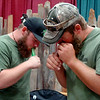 Tyler Whittaker and Hershel Woodside, with Tradition Outdoors, use game calls during the KNID Sportsman's and Outdoor Expo at the Chisholm Trail Coliseum Saturday, August 23, 2014. The event continues Sunday from 10 a.m.-5 p.m. (Staff Photo by BONNIE VCULEK)