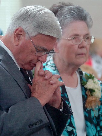 Rev. Jack Garrison pauses for a moment of quiet meditation near his wife, Marilyn, as the Enid United Pentecostal Church at 1168 E. Chestnut celebrates Rev. Garrison's 50th anniversary as their pastor Saturday, August 02, 2014. (Staff Photo by BONNIE VCULEK)