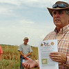 """Dr. Tom Royer, Oklahoma State University IPM Coordinator, discusses the """"ID, Impacts & Control of Sugar Cane Aphids"""" on sorghum during a Grain Sorghum Tour northwest of Cherokee Tuesday, August 26, 2014. (Staff Photo by BONNIE VCULEK)"""