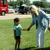 Gov. Mary Fallin greets a young lady outside the Chisholm Trail Coliseum during Gov. Fallin's 2014 re-election campaign bus tour Saturday, August 23, 2014. (Staff Photo by BONNIE VCULEK)