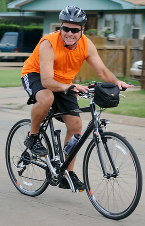 Capt. Jack Morris, with the Enid Police Department, sprints east on Randolph near NWOSU during the 9th annual AMBUCS Tour de Trykes at David Allen Memorial Ballpark Saturday, August 16, 2014. The courses ranged from 2, 14, 26, and 42 miles or a 100k race. More than 400 bicyclists registered for the ride that raises money for local AMBUCS projects. (Staff Photo by BONNIE VCULEK)