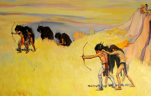 """Ruth Monro Augur's No. 1 mural """"The Hunting Trail"""" shows Indians pursuing buffalo before they possessed horses. The mural is located on the north wall of the west entrance to the Garfield County Courthouse. (Staff Photo by BONNIE VCULEK)"""