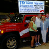 Debbi and Jerry Coleman, with Into the Blue Dive Shop in Enid, pause for a portrait with Gov. Mary Fallin and her husband Wade Christensen during the KNID Sportsman's and Outdoor Expo at the Chisholm Trail Coliseum Saturday, August 23, 2014. (Staff Photo by BONNIE VCULEK)