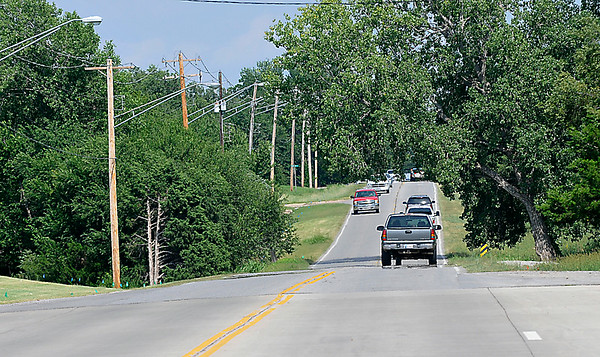 Looking east down Willow from Oakwood Friday August 1. The city estimates the cost of replacing the water line along Willow at $1 million dollars. (Staff Photo by BILLY HEFTON)