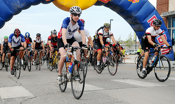 Riders begin the 9th annual AMBUCS Tour de Trykes at David Allen Memorial Ballpark Saturday, August 16, 2014. The courses ranged from 2, 14, 26, and 42 miles or a 100k race. More than 400 bicyclists registered for the ride that raises money for local AMBUCS projects. (Staff Photo by BONNIE VCULEK)