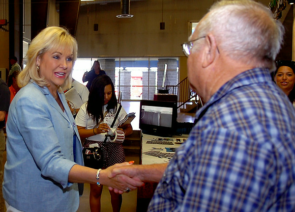 Oklahoma Gov. Mary Fallin (second, from left) greets supporters during the KNID Sportsman's and Outdoor Expo at the Chisholm Trail Coliseum Saturday, August 23, 2014. Gov. Fallin and her husband Wade Christensen were on a re-election campaign bus tour around Oklahoma. (Staff Photo by BONNIE VCULEK)