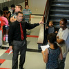 "Sixth-grade students wait outside the Longfellow Middle School office for their schedules as LMS Principal Scott Fitzgerald directs another student to her classrooms during ""Saddle Up"" orientation Wednesday, August 13, 2014. (Staff Photo by BONNIE VCULEK)"