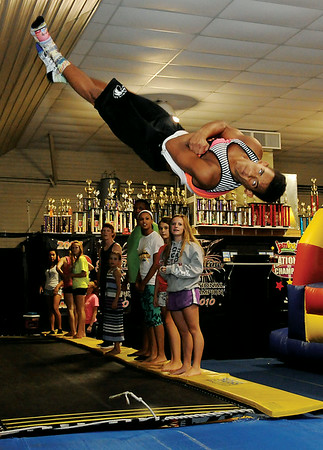 """Jadrien Stubblefield, a Kremlin-Hillsdale High School senior, completes a double full during """"A Decade of Success"""" celebration at Spirit Express Wednesday, August 6, 2014. Activities during the event included tumbling, swimming at Champlin Pool, grilled hot dogs and prizes. (Staff Photo by BONNIE VCULEK)"""