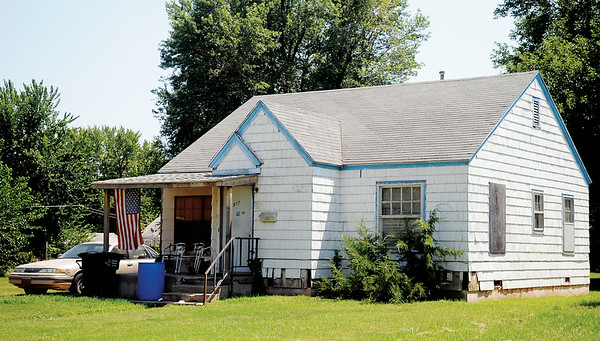 This is the home, 517 W. Poplar, where Enid Police allege Hubert Ray Decastro shot and wounded his son Frederick Decastro in Enid, Okla. Saturday, August 9, 2014. (Staff Photo by BONNIE VCULEK)