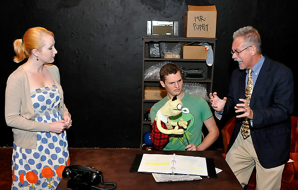 "(Left to Right) Chelsea Hunter, Chandler Jackson and Frank Baker rehearse the Turpin Theater production of ""Mr. Puppet goes to Television"" August 7. (Staff Photo by BILLY HEFTON)"