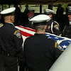 """The Enid Police Department Honor Guard honor Retired Capt. Glenn """"Red"""" Willard Harmon during the Interment Ceremony at Memorial Park Cemetery Tuesday, August 26, 2014. (Staff Photo by BONNIE VCULEK)"""