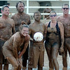 The Rum Boats, from Enid, place second during the 3rd annual Enid Miracle League Mud Volleyball Tournament at the Garfield County Fairgrounds Saturday, August 02, 2014. (Staff Photo by BONNIE VCULEK)