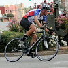 Team Vance's Matt Bell takes an early lead during the Men's Open at the AMBUCS Twilight Criterium in downtown Enid Saturday, August 16, 2014. (Staff Photo by BONNIE VCULEK)