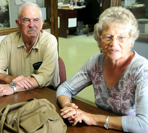 Charlie Cunningham (left) listens as his wife Dee explains how physicians at Integris Bass Baptist Hospital diagnosed her husband's critical health issues and helped save his life. (Staff Photo by BONNIE VCULEK)