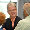 U.S. Senator Tom Coburn, M.D. visits with a couple prior to a town hall meeting Monday at Enid's Convention Hall. (Staff Photo by BILLY HEFTON)