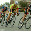 AMBUCS Twilight Criterium riders sprint up Grand onto Randolph during the women's open race in downtown Enid Saturday, August 16, 2014. The ladies finished the race before heavy rain and hail covered the downtown square. (Staff Photo by BONNIE VCULEK)