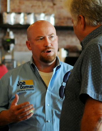 Joe Dorman, Democratic candidate for Governor, visits with David Ezzell during a campaign stop at 580 Coffeehouse Saturday, August 16, 2014. (Staff Photo by BONNIE VCULEK)