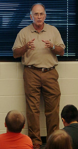 Stan Brownlee, a mentor for Enid Public Schools, discusses life lessons with fifth-grade students at Garfield Elementary School Friday, August 29, 2014. (Staff Photo by BONNIE VCULEK)