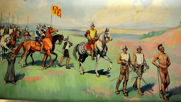 """Ruth Monro Augur's No. 2 mural """"Explorer's Trail"""" presents General Francisco Vasquez de Coronado and his expedition crossing the Cherokee Strip in June 1541. The mural is located on the south wall of the west entrance to the Garfield County Courthouse. (Staff Photo by BONNIE VCULEK)"""