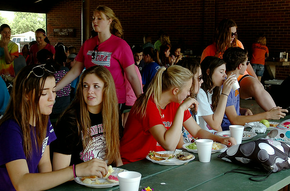 OBA High School students, grades 9-12, enjoy lunch at Meadowlake Park during their annual fun day festivities Wednesday, August 20, 2014. Frisbee football, volleyball, basketball, tennis, water balloon fights and an afternoon at Splash Zone filled the day. (Staff Photo by BONNIE VCULEK)
