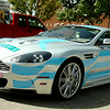 Dr. David Vanhooser's 2009 Aston Martin DBS, which features graphics promoting Enid, will be driven by Vanhooser and Aaron Brownlee, from Wymer Brownlee, during this year's Fireball Run, coming to Enid Sept. 30. The vehicle was on static display during Enid Mack Motor Mania at Leonardo's Children's Museum Saturday, August 23, 2014. (Staff Photo by BONNIE VCULEK)