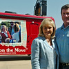 Okla. Gov. Mary Fallin and her husband Wade Christensen pause near Gov. Fallin's campaign bus outside the KNID Sportsman's and Outdoor Expo at the Chisholm Trail Coliseum in Enid Saturday, August 23, 2014. (Staff Photo by BONNIE VCULEK)