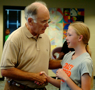 Stan Brownlee, a mentor for Enid Public Schools, greets fifth-grade students as they enter their pod at Garfield Elementary School Friday, August 29, 2014. (Staff Photo by BONNIE VCULEK)