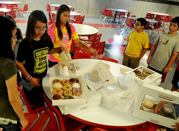 """Longfellow Middle School sixth-grade students enjoy breakfast during their """"Saddle Up"""" orientation Wednesday, August 13, 2014. The LMS Mustangs begin classes next Tuesday, August 19. (Staff Photo by BONNIE VCULEK)"""