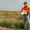 """Trent Milacek, Northwest Area Economist, discusses the """"Grain Price Outlook"""" during a Grain Sorghum Tour west of Cherokee Tuesday, August 26, 2014. (Staff Photo by BONNIE VCULEK)"""