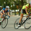 Women compete during the AMBUCS Twilight Criterium ladies' open division in downtown Enid Saturday, August 16, 2014. (Staff Photo by BONNIE VCULEK)
