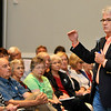 U.S. Senator Tom Coburn, M.D. gestures as he answers a question during a town hall meeting Monday at Enid's Convention Hall. (Staff Photo by BILLY HEFTON)