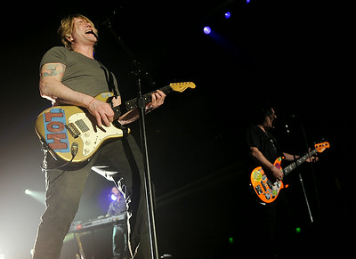 The Goo Goo Dolls' guitarist and vocalist John Rzeznik, bassist and vocalist Robby Takac perform at the Enid Event Center during the Daughtry/Goo Goo Dolls Summer Tour in Enid, Okla. Tuesday, August 05, 2014. (Staff Photo by BONNIE VCULEK)