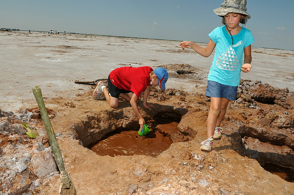 Camden and Kaedon Colaw, from Edmond, dig for selenite crystals Saturday at the Salt Plains National Wildlife Refuge near Jet. Crystal digging is allowed until October 15. (Staff Photo by BILLY HEFTON)