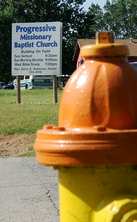 A fire hydrant is located across the street from Progressive Missionary Baptist Church at the corner of 12th and Ash Sunday, August 24, 2014. The city of Enid said the church, which is located at 12th and Ash, would have to pay for another water line installation to build a new sanctuary, but later re-tested and the church may expand when funds are available. (Staff Photo by BONNIE VCULEK)