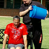Deacon Tony Crispo shivers after his ALS Ice Challenge drenching from Rev. Joseph Irwin at St. Joseph Catholic School Friday, August 22, 2014. Student donations and matching funds from Crispo will be sent to the John Paul II Medical Research Institute, whose research is pro-life driven. (Staff Photo by BONNIE VCULEK)